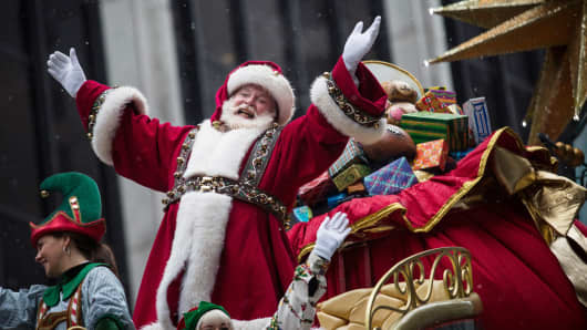 Santa Claus waves to the crowd during the Macy's Thanksgiving Day Parade in New York City.