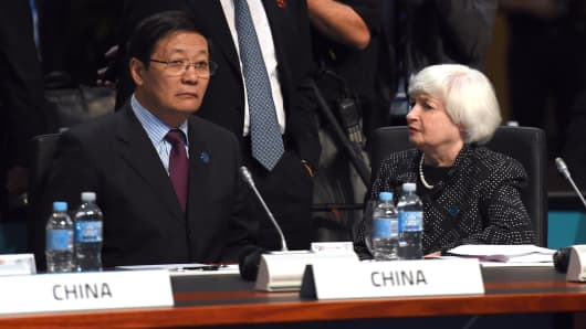 Federal Reserve Chair Janet Yellen (R) chats with China's Minister of Finance Lou Jiwei (L) at the G-20 Finance Ministers and Central Bank Governors Meeting in Cairns, Australia, on Sept. 20, 2014.