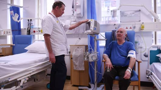 A patient has his blood pressure measured at the Royal Albert Edward Infirmary in Wigan, North West England.