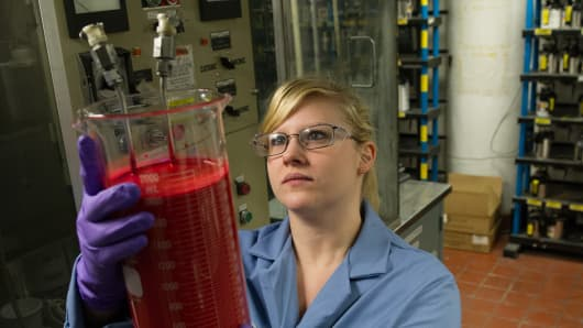 A PPG quality assurance technician examines a paint formula at one of PPG's coatings manufacturing facilities.
