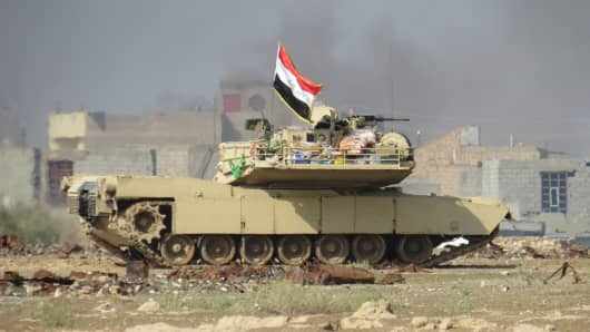A tank belonging to the Iraqi security forces is seen during patrol after clashes between Iraqi security forces and Islamic State at Al- Anbar province in Ramadi, Iraq on November 20, 2015.