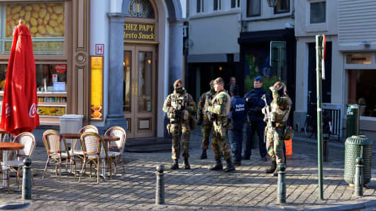 Belgian security forces patrol streets in Brussels, where all stores had to close following the terror alert level being elevated to 4.