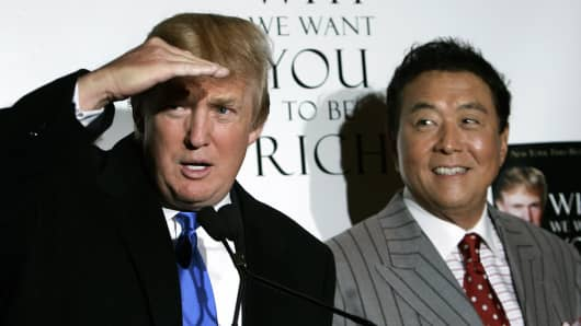 Presidential candidate Donald Trump (L) and author Robert Kiyosaki hold a press conference in October 2006 for their book titled 'Why We Want You To Be Rich - Two Men - One Message.'