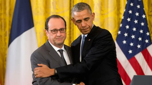 President Obama shakes hands with French President Francois Hollande in the East Room of the White House, Nov. 24, 2015.