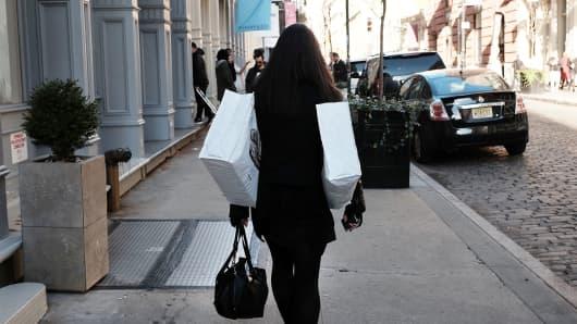 A shopper walks through lower Manhattan in New York City.