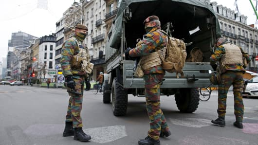Belgian soldiers patrol in central Brussels as police search the area during a continued high level of security following the recent deadly Paris attacks, Belgium, November 24, 2015.