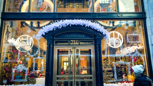 A woman walks past the holiday window display at Henri Bendel on 5th Avenue in New York.