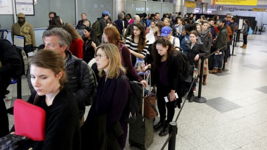 Travelers wait in line at a security checkpoint at New York's LaGuardia Airport, Nov. 25, 2015.