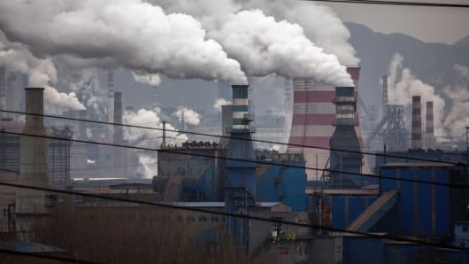 Smoke billows from smokestacks and a coal fired generator at a steel factory in the industrial province of Hebei, China.