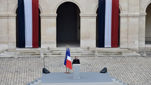 French President Francois Hollande delivers a speech during the national tribute