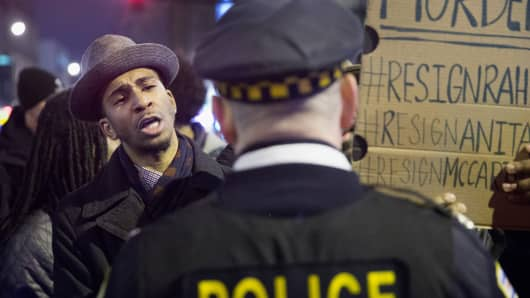 Demonstrators confront police during a protest over the death of Laquan McDonald on November 25, 2015 in Chicago, Illinois.