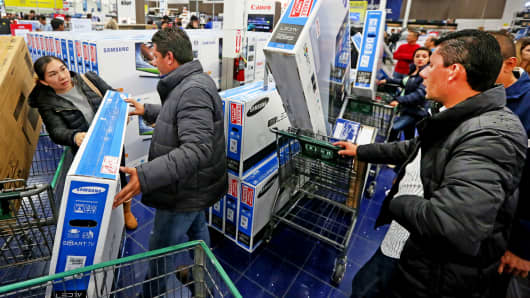 Shoppers purchase electronics and other items at a Best Buy in San Diego, California.