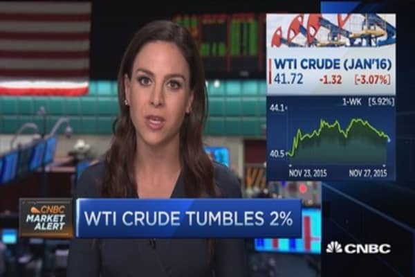 Crude tumbles on stronger dollar
