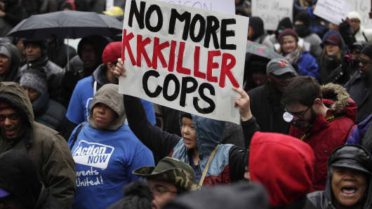 In a separate incident, demonstrators protest the fatal shooting of Laquan McDonald along the Magnificent Mile November 27, 2015 in Chicago.
