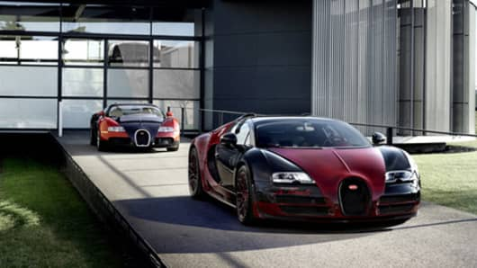 The Bugatti 16.4 Grand Sport Vitesse La Finale (foreground) and the Veyron at Bugatti headquarters in Molsheim, Alsace, France.
