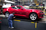 A General Motors worker puts the finishing touches on a new 2016 Chevrolet Camaro at the Lansing Grand River Assembly Plant October 26, 2015 in Lansing, Michigan.