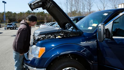 A customer looks at a Ford F-150 pickup truck in Brandywine, Maryland.