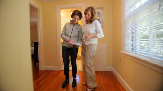 A potential buyer tours an open house in Boston, MA.