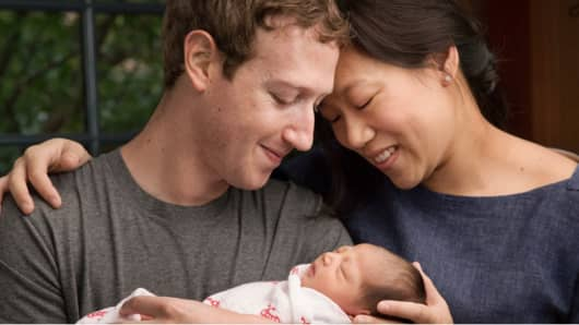 Mark Zuckerberg with wife Priscilla Chan and their daughter Max.