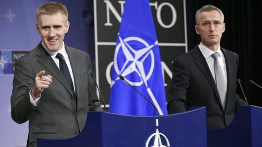 Montenegro's Deputy Prime minister and Minister of Foreign Affairs Igor Luksic (L) and NATO Secretary General Jens Stoltenberg give a joint press conference at the NATO headquarters in Brussels on December 02, 2015.