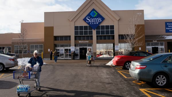 Shoppers leave a Sam's Club store in Rolling Meadows, Illinois.
