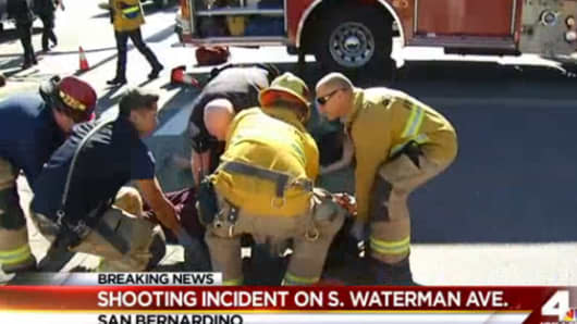 First responders attend to victims of a active shooter in San Bernardino, Calif on Dec. 2, 2015.