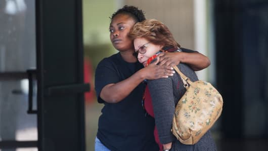 Two women embrace at a community center where family members are gathering to pick up survivors after a shooting rampage that killed multiple people and wounded others at a social services center in San Bernardino, Calif., Dec. 2, 2015.