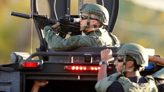 Police officers conduct a manhunt after a mass shooting in San Bernardino, California December 2, 2015.