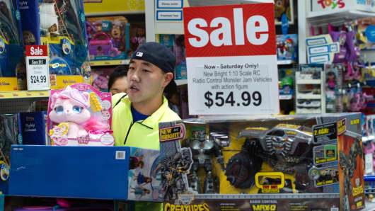 A customer is seen shopping in a Toys-R-US store in Fairfax, Virginia.