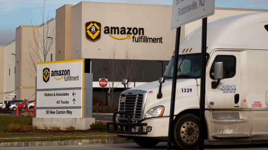 A truck drives past the Amazon.com fulfillment center in Robbinsville, New Jersey.