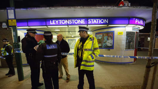Police officers and crime scene investigators investigate a crime scene at Leytonstone tube station in east London, England, on December 05, 2015 after a man was seriously injured in a knife attack.