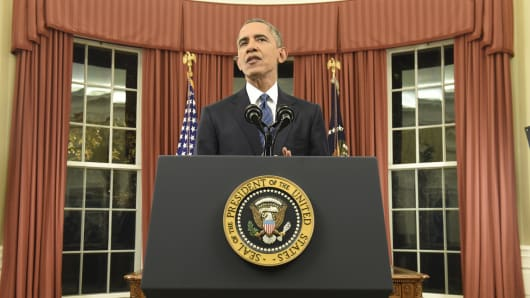 President Barack Obama speaks about counter-terrorism and the United States fight against Islamic State during an address to the nation from the Oval Office of the White House in Washington, December 6, 2015.