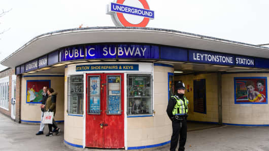 A police officer stands guard outside Leytonstone station, London on December 6, 2015.