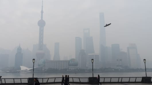 Buildings of the Lujiazui Financial District are shrouded in smog on Nov. 30, 2015, in Shanghai.