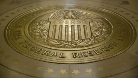 The Board of Governors of the Federal Reserve seal is displayed on the floor outside the board room in Washington, D.C.