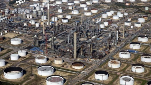 Oil storage tanks and refining facilities sit at the Esso oil refinery, operated by Exxon Mobil Corp. in Fawley, U.K.