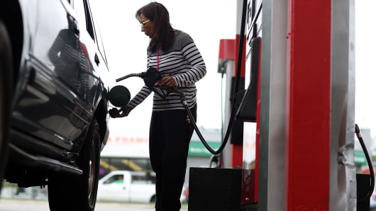 A woman fills her vehicle with gas at a U-Gas station in Miami, Florida.