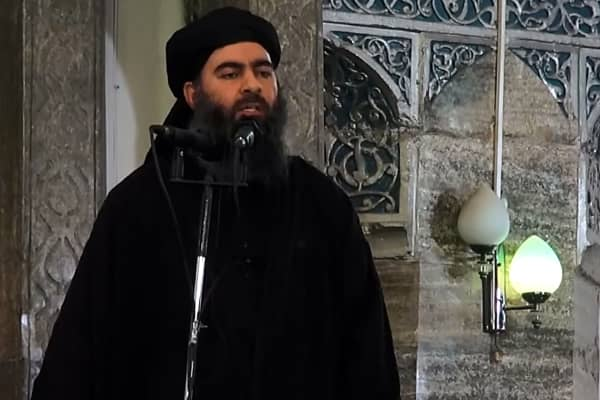 An image grab taken from a video released on July 5, 2014 by Al-Furqan Media shows alleged Islamic State of Iraq and the Levant (ISIL) leader Abu Bakr al-Baghdadi preaching during Friday prayer at a mosque in Mosul.