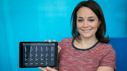 CNBC's Meg Tirrell holds up her genome sequence on an iPad app by Illumina.
