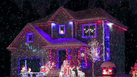Marvelous Star Shower Laser Light Projected On A House During Christmas.