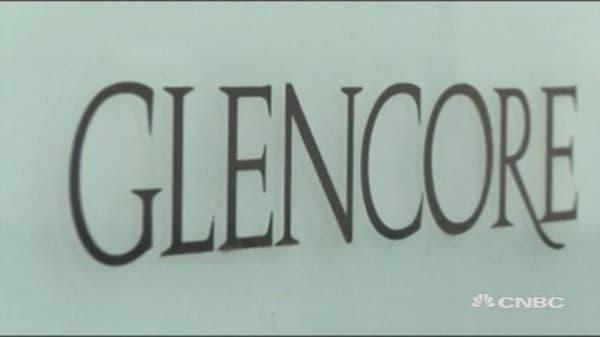 Glencore ups debt reduction