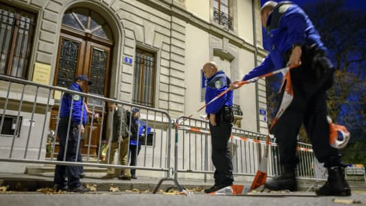 Geneva police officers set up a police cordon in front of the French consulate in Geneva a day after the Paris terror attacks