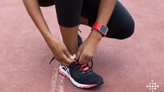 A runner wearing a Fitbit.