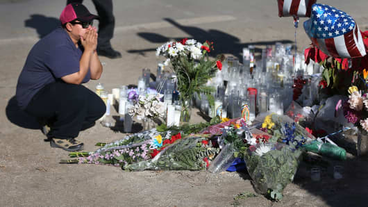 A woman pays her respects at a memorial near the Inland Regional Center on Dec. 5, 2015 in San Bernardino, California, three days after the massacre.