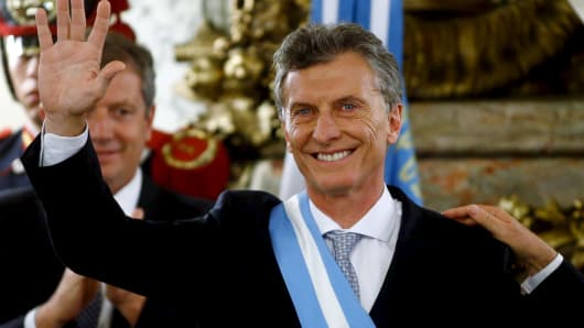 Argentina's President Mauricio Macri waves after being sworn-in as president at Casa Rosada Presidential Palace in Buenos Aires, Argentina, December 10, 2015.