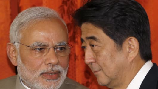 Indian Prime Minister Narendra Modi (L) chats with Japanese Prime Minister Shinzo Abe during a signing ceremony at Akasaka State Guest House in Tokyo on September 1, 2014.