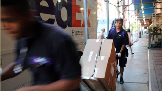 FedEx employees make deliveries in Manhattan.