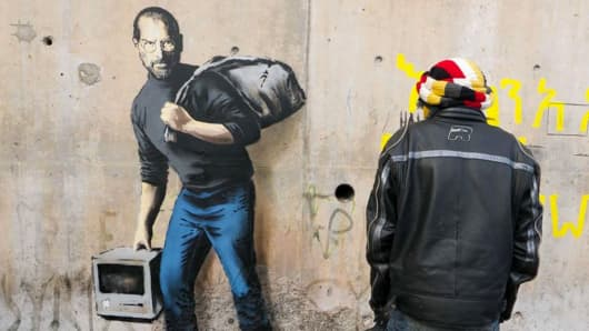 Steve Jobs is featured in a Banksy mural at a refugee camp in France.
