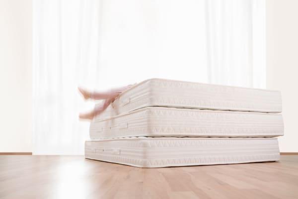 Mattress on wood floor