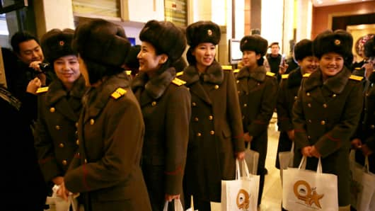 Members of the North Korean female music group Moranbong Band arrive at a hotel after concert rehearsal on December 11, 2015 in Beijing, China.